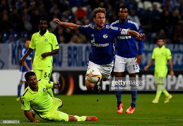 Braian Lluy of Asteras challenges Benedikt Hoewedes of Schalke during the UEFA Europa League Group K match between FC Schalke 04 and Asteras Tripolis...