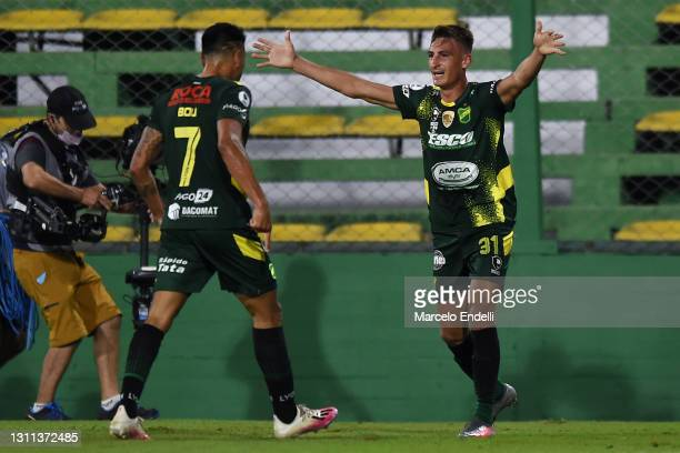 Braian Romero of Defensa y Justicia celebrates with teammate Walter Bou after scoring the first goal of his team during match between Defensa y...