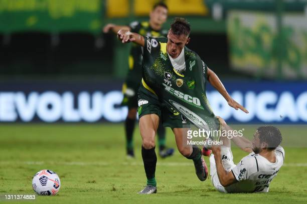 Braian Romero of Defensa y Justicia fights for the ball with Matias Vina of Palmeiras during match between Defensa y Justicia and Palmeiras as part...