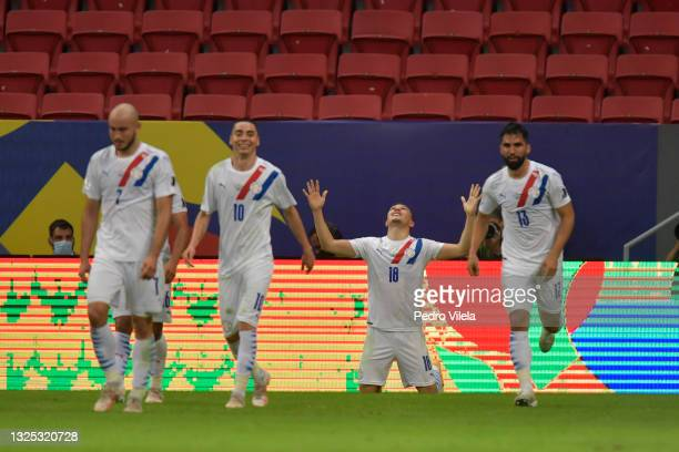 Braian Samudio of Paraguay celebrates with teammates after scoring the first goal of his team during a Group A match between Chile and Paraguay as...