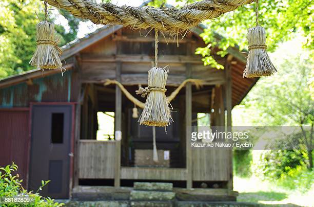 Braided Rope Decoration With Temple In Background