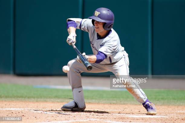 Braiden Ward of University of Washington bunts the ball during a baseball game against UCLA at Jackie Robinson Stadium on May 19 2019 in Los Angeles...