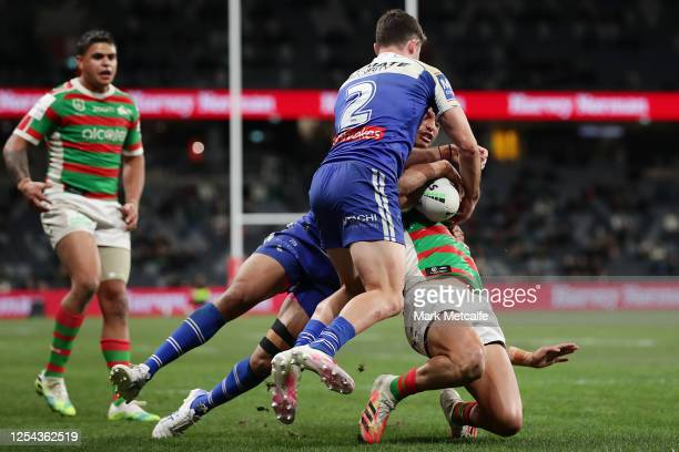 Braidon Burns of the Rabbitohs is tackled causing an injury during the round eight NRL match between the Canterbury Bulldogs and the South Sydney...