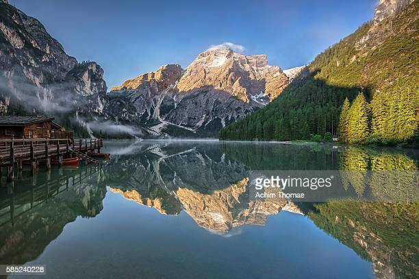 braies lake - dolomite alps, south tyrol, italy - toblach stock photos and pictures