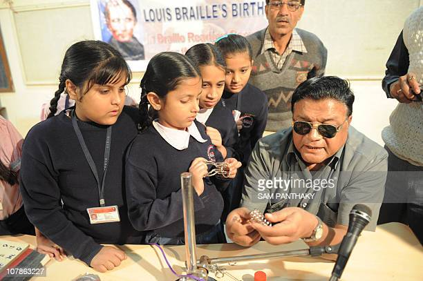 Braille instructor Rahimkhan Pathan discusses with school girls at the Blind People's Association in Ahmedabad on January 4 on the 202nd birth...
