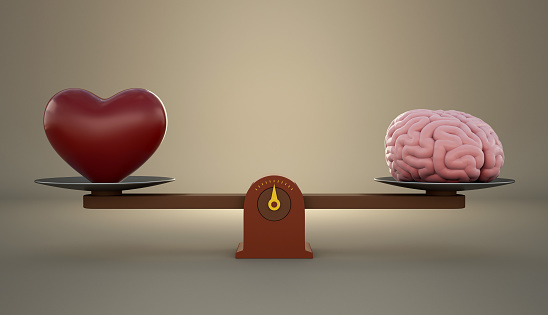 Brain and heart on a wooden balance scale. 875518522