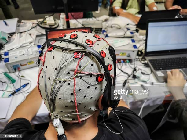 brain computer interface lab equipments - eeg stock pictures, royalty-free photos & images