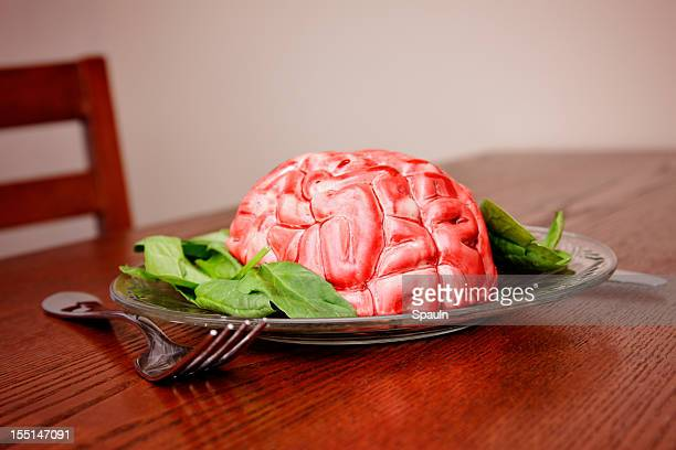 brain food - cannibalism stock photos and pictures
