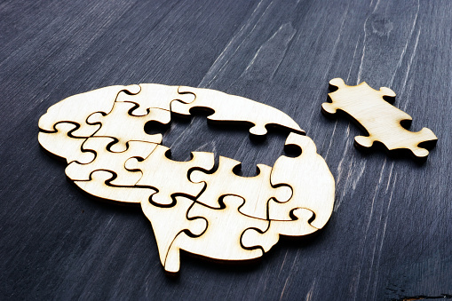 Brain from wooden puzzles. Mental Health and problems with memory. 1197104185