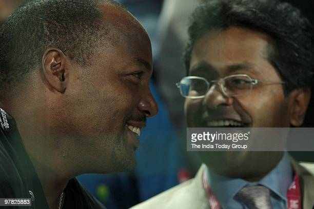 Brain Lara and Lalit Modi watch the match between Mumbai Indians and Delhi Daredevils in New Delhi on Wednesday