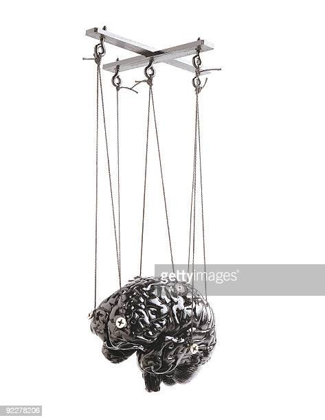 brain marionette isolated - puppet stock pictures, royalty-free photos & images