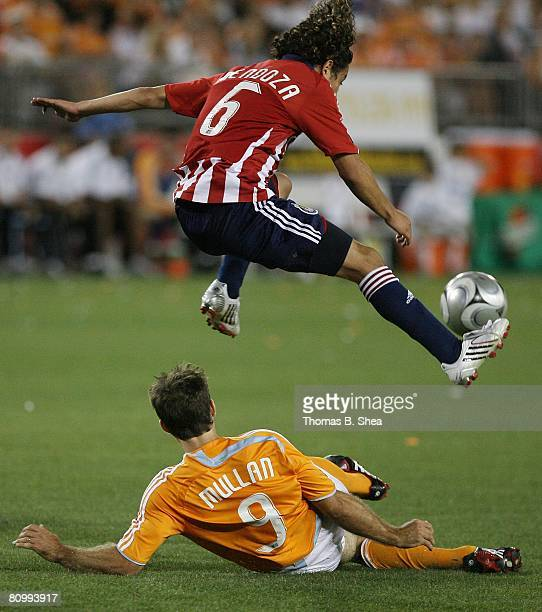 Brain Mullan of the Houston Dynamo slide tackles Francisco Mendoza of Chivas USA on May 3 2008 at Robertson Stadium in Houston Texas