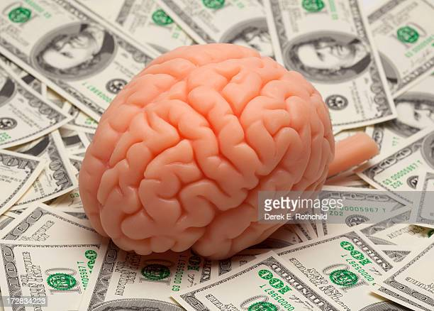 Brain on a pile of money