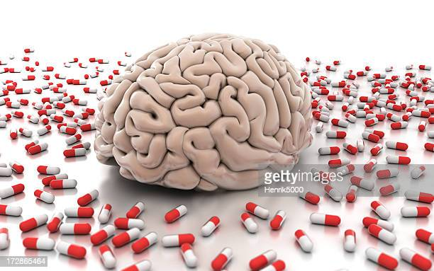 Brain surrounded by pills