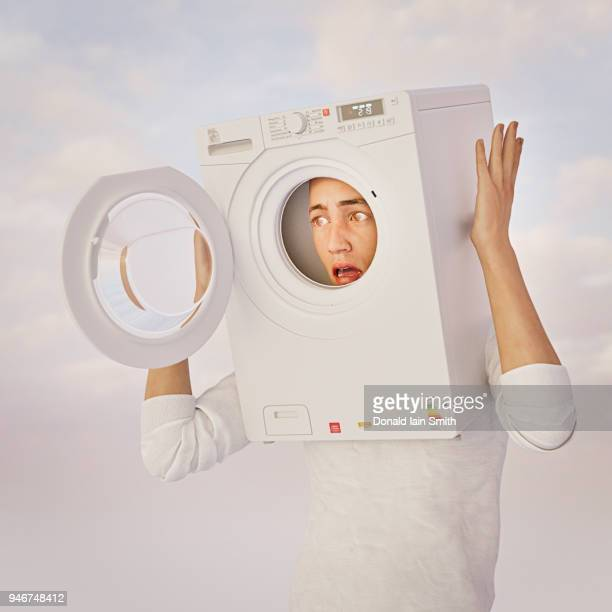 Brain washing: young man with washing machine on his head.