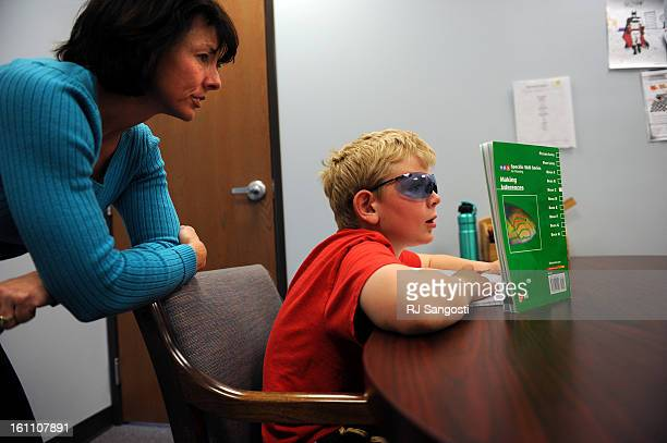 BRAIN07Nineyearold Ricky Heilbron works on his cognitive skills with Susan Gobbo at The Brain Balance Achievement Center in Golden The Brain Balance...