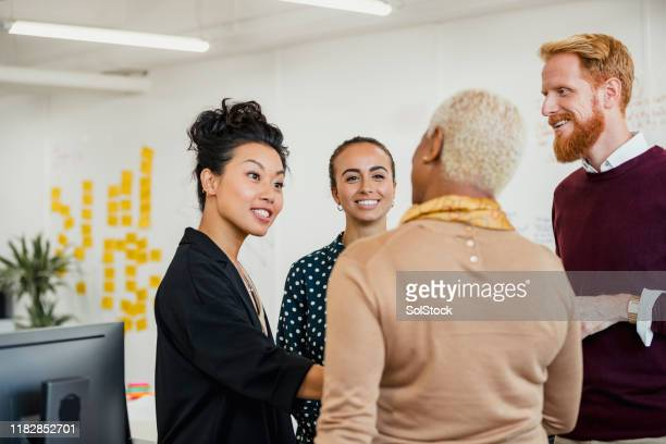 brainstorming as a group - multiracial group stock pictures, royalty-free photos & images