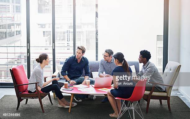 brainstorming session in progress - casual clothing stock pictures, royalty-free photos & images