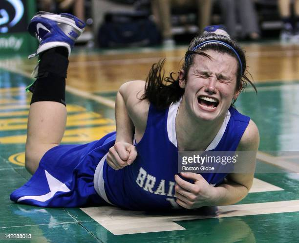 Braintree High School girls basketball's Rachel Norton is in pain after taking a tumble under the boards during second half rebounding action but she...