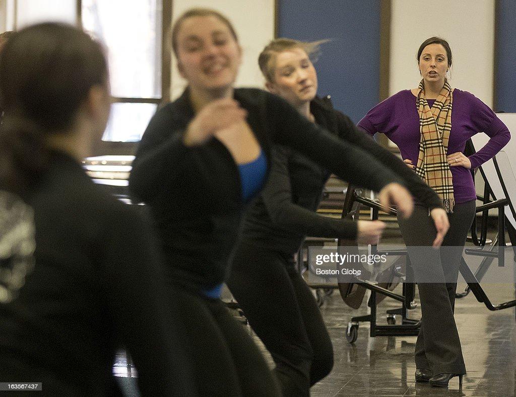Braintree High Varsity Dance Team coach Jamie Campbell drills her team during practice in Braintree High's Cafiteria on Monday, Feb. 4, 2013.