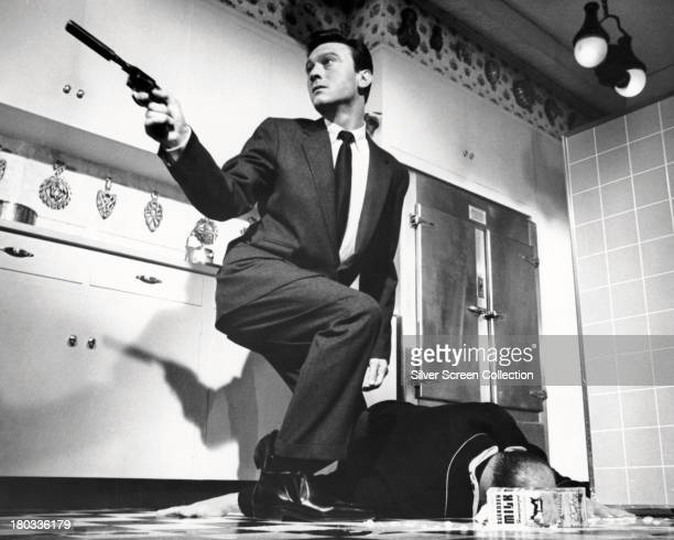 Brainwashed assassin Raymond Shaw played by Laurence Harvey murders Senator Jordan played by John McGiver in 'The Manchurian Candidate' directed by...