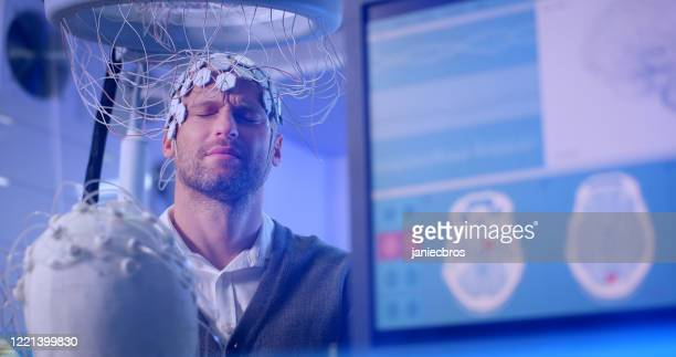 brainwave scanning headset test in laboratory - eeg stock pictures, royalty-free photos & images