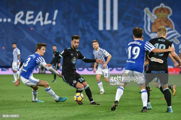 Brais Mendez of Celta duels for the ball with Diego Llorente of Real Sociedad during the Spanish league football match between Real Sociedad and...