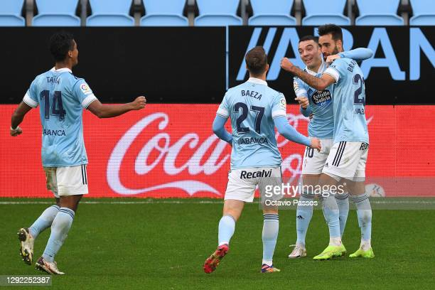 Brais Mendez of Celta Vigo celebrates with teammates after scoring their team's second goal during the La Liga Santander match between RC Celta and...