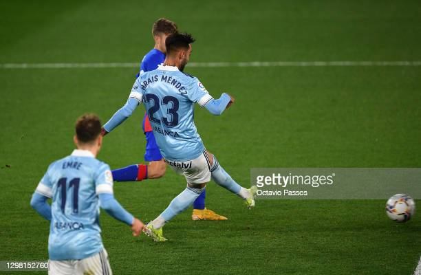 Brais Mendez of Celta Vigo scores their sides first goal during the La Liga Santander match between RC Celta and SD Eibar at Abanca-Balaídos on...
