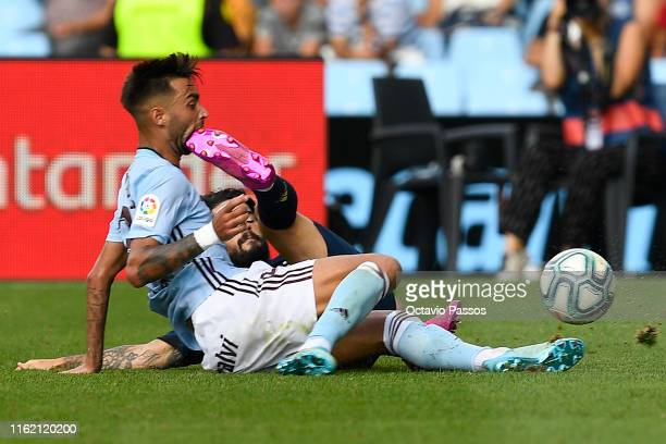 Brais Mendez of RC Celta competes for the ball with Isco of Real Madrid during the Liga match between RC Celta de Vigo and Real Madrid CF at...