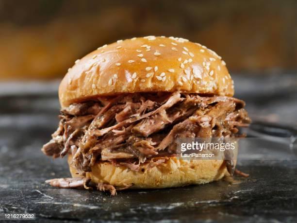 braised beef short rib sandwich on a brioche bun - brioche stock pictures, royalty-free photos & images