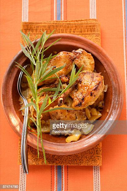 Braised chicken with onions and tarragon in tajine