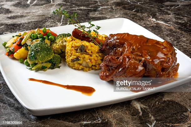 braised lamb shank with vegetables and pilau rice - tradition stock pictures, royalty-free photos & images