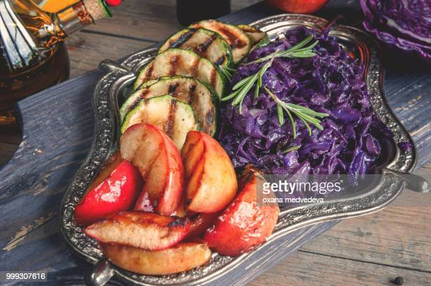 Braised red cabbage with grilled chunks of apples and onions, seasoning with lemon and olive oil...