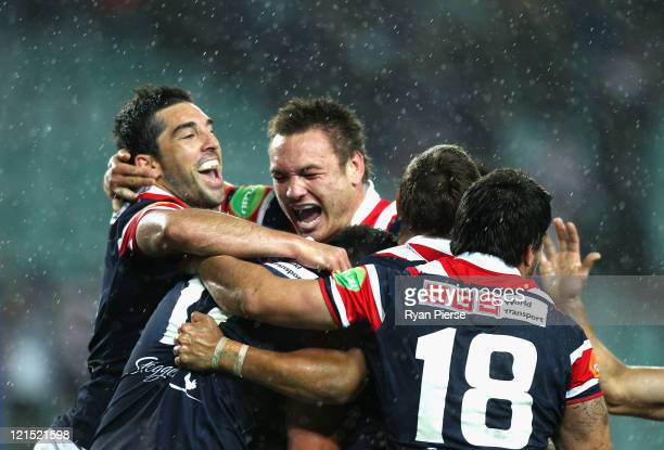 Braith Anasta and Jared WaereaHargraves of the Roosters celebrates the winning try during the round 24 NRL match between the Sydney Roosters and the...
