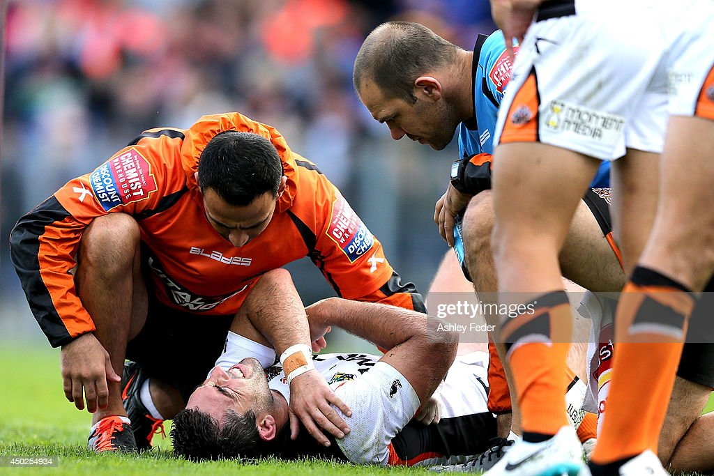 Braith Anasta lays on the ground injured during the round 13 NRL match between the Newcastle Knights and the Wests Tigers at Hunter Stadium on June 8, 2014 in Newcastle, Australia.