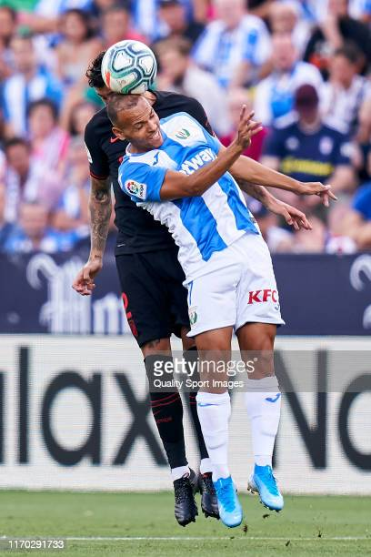 Braithwaite of Leganes battle for the ball with Mario Hermoso of Atletico de Madrid during the La Liga match between Legates and Atletico Madrid on...