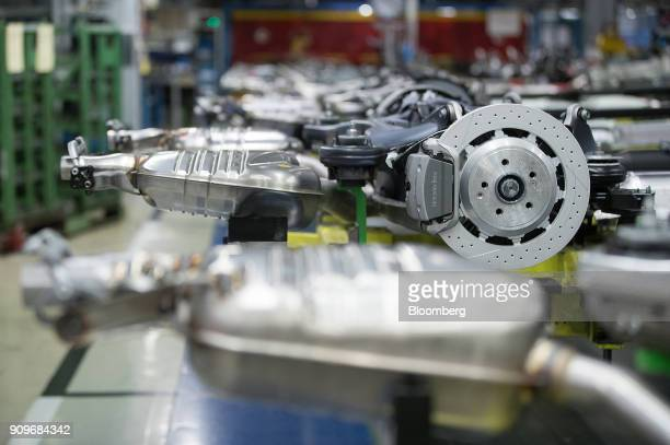 Brake discs sit on a powertrain system on the MercedesBenz SClass automobile production line at the automaker's factory in Sindelfingen Germany on...