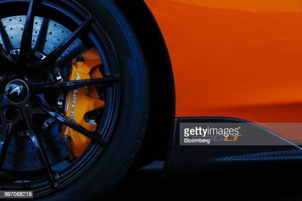 A brake disk sits on the McLaren 600LT supercar manufactured by McLaren Automotive Ltd during its launch at the Goodwood Festival of Speed near...