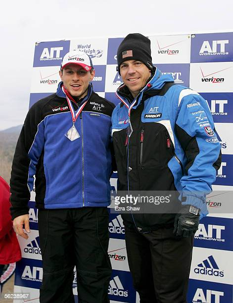 Brakeman Pavle Jovanovic and driver Todd Hays of the USA who finished in third place celebrate on the podium after the FIBT Men's TwoMan Bobsled...
