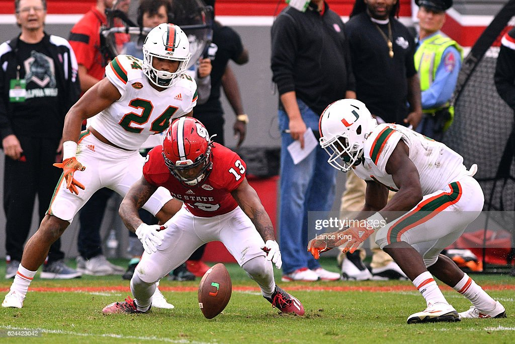 Bra'Lon Cherry #13 of the North Carolina State Wolfpack fumbles the ball after calling for a fair catch following a Miami Hurricanes punt at Carter-Finley Stadium on November 19, 2016 in Raleigh, North Carolina. Miami won 27-13.