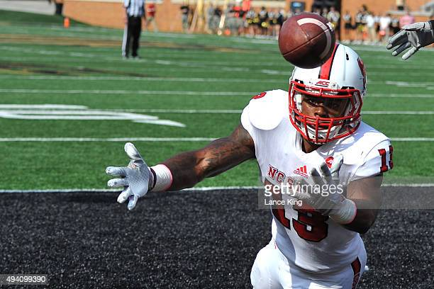 Bra'Lon Cherry of the North Carolina State Wolfpack misses a pass in the end zone against the Wake Forest Demon Deacons at BBT Field on October 24...