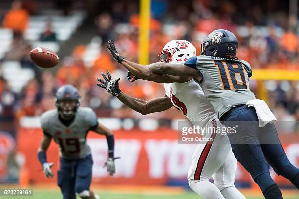 Bra'Lon Cherry of the North Carolina State Wolfpack pulls in a reception as Scoop Bradshaw of the Syracuse Orange defends on November 12 2016 at The...