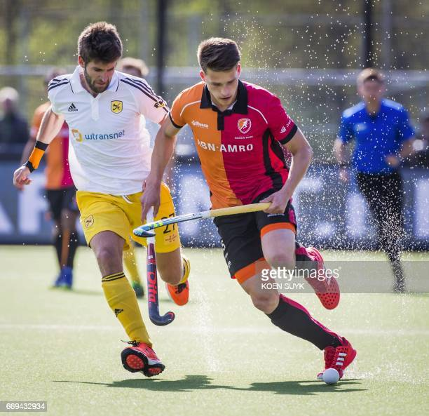 Bram Huijbregts of OranjeRood fights for the ball with Marc Torrente of Atletic Terrassa during the quarter final hockey match between Wimbledon and...