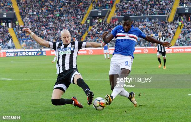 Bram Nuytinc of Udinese Calcio competes with Duvan Zapata of UC Sampdoria during the Serie A match between Udinese Calcio and UC Sampdoria at Stadio...