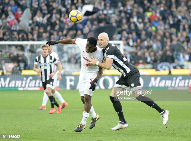 Bram Nuytinc of Udinese competes with Franck Yannick Kessie' of AC Milan during the serie A match between Udinese Calcio and AC Milan at Stadio...