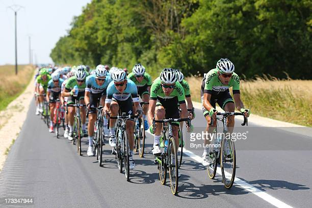 Bram Tankink and Lars Boom of the Netherlands and Belkin drive the pace of the leading group during stage thirteen of the 2013 Tour de France, a...