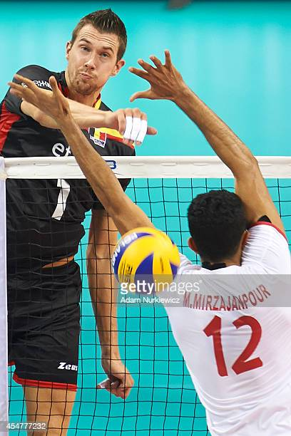 Bram Van Den Dries of Belgium spikes the ball during the FIVB World Championships match between Belgium and Iran at Cracow Arena on September 6, 2014...