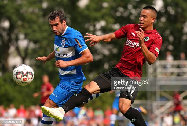 Bram van Polen of PEC Zwolle and Niclas Fuellkrug of Hannover battle for the ball during the preseason friendly match between Hannover 96 and PEC...