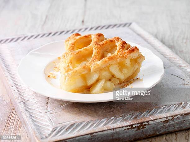 Brambly apple pie slice on wooden chopping board